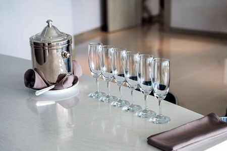 Arrangement of wine glass with stainless bucket on marble bar Reklamní fotografie - 134791373