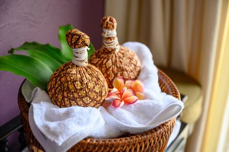 Thai massage with herbal hot compress ball on wooden tray Reklamní fotografie - 134791374