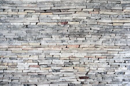 Horizontal stacked granite stone brick wall, pattern and background Reklamní fotografie - 134791391