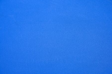 Texture blue synthetic rubber field of tennis court background