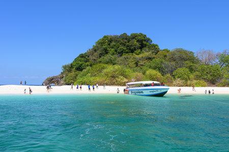 Satun, Thailand - Feb 21 2019 : Tourists travel on white sand beach in tropical sea at Koh Kai, Lipe island