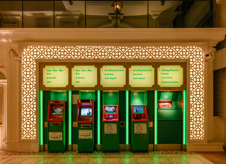 Phuket, Thailand - Dec 12 2018 : Rows of counter Kasikorn bank or K-Bank for deposit and cash with lighting at night