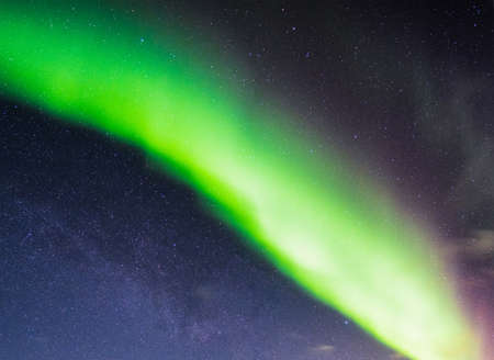 Northern lights or Aurora borealis in the night sky over arctic circle in Scandinavia country