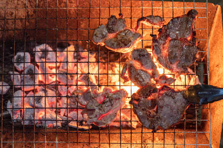 Grilled marinated pork on charcoal grill in party dinner