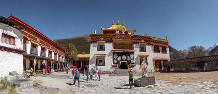 Sichuan, China - OCT 22 2018 : Ancient tibetan Chunggu temple with tourists traveling in Shangri-la, Yading nature reserve