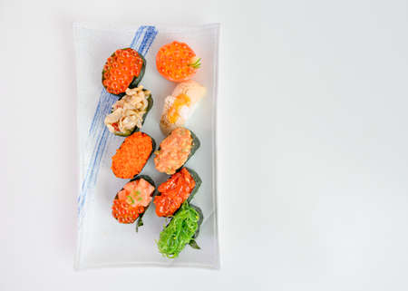 Salmon with ikura spicy sauce seaweed sushi roll japanese cusine. isolated on white background