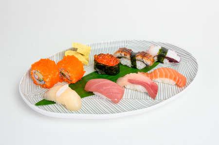 Variety of japanese nigiri sushi set of traditional food on white plate