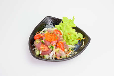 Maguro salad with spicy sauce in ceramic bowl Reklamní fotografie