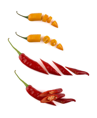 Chopped chili peppers isolated on white background photo