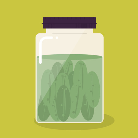food preservation: Pickled cucumber in glass can on yellow background