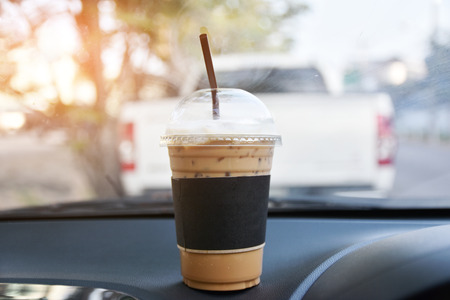 cool coffee in car parked on road for drink before drive Imagens