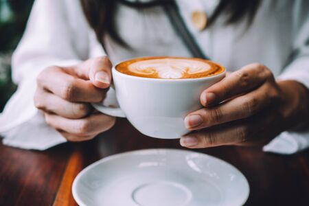 Women sitting in coffee shop for drink in coffee time