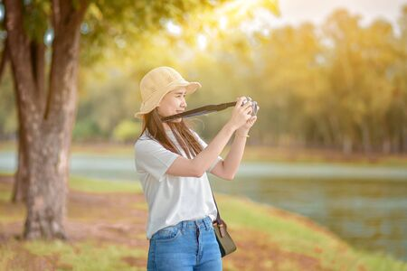 Asian Women camera Travel and Take photo Nature