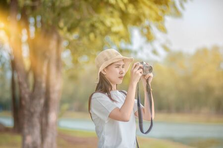 Asian Women camera Travel and Take photo Nature Stock fotó
