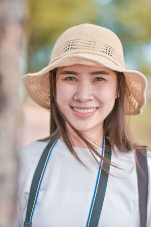 Close up face of Asian Beauty women with white hat at Park outdoor Stock fotó