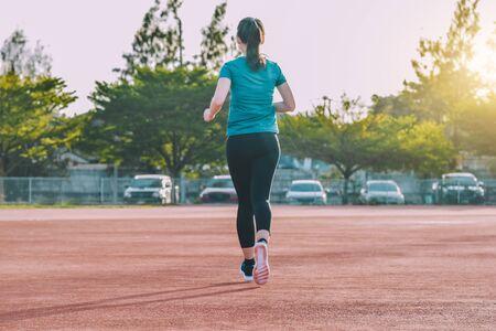 Runner Women jogging or running in evening at sunlight