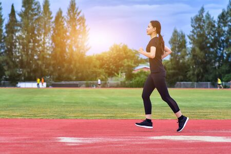 Runner Women jogging or running in evening at sunlight,Lady run jogging or exercise,Woman Runner or Girl Running Stock fotó