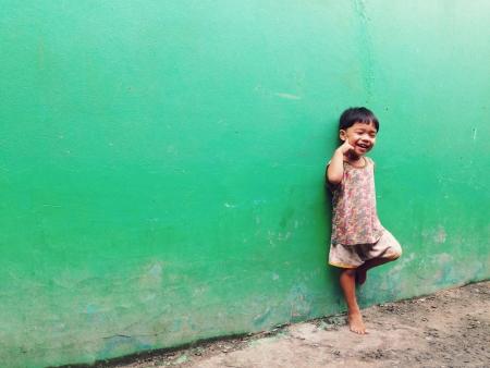 slum: Laughing children in the slum Stock Photo