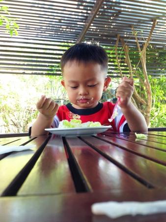 isolated: Kid enjoy eating