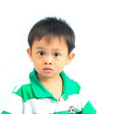 Portrait of little boy isolated on white background photo