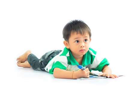Little boy on a floor with a diary  Isolated over white background  photo