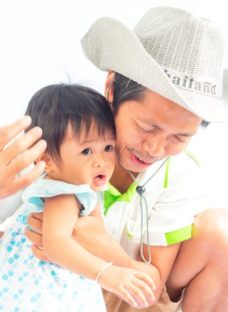 Happy young man holding and kissing daughter isolated on white photo
