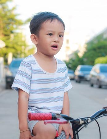 stabilizers: asian kid on bike