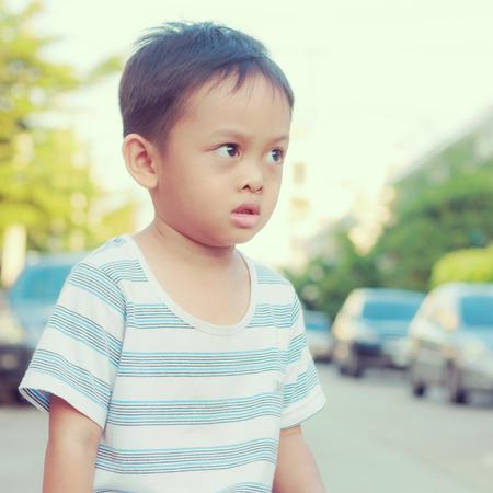 asian kid on bike photo
