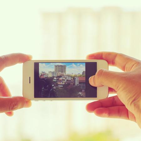 Man taking a photo with phone in  Bangkok photo
