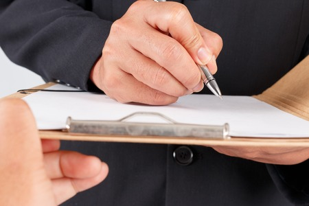undersign: Businessman working with documents sign up contract