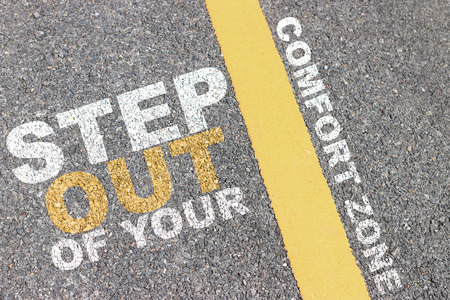 give way: Asphalt road area with yellow stripes and lettering motivation.