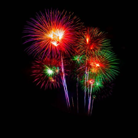Beautiful colorful fireworks display on the sea beach, Amazing holiday fireworks party or any celebration event in the dark sky.
