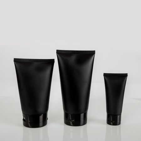 black cosmetic tube cream lotion facial foam sunscreen makeup beauty cosmetic foundation with background