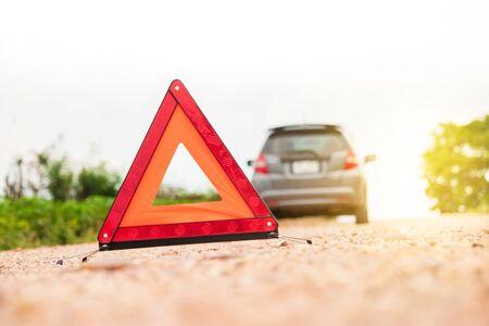 Emergency stop sign and broken car on road. Archivio Fotografico