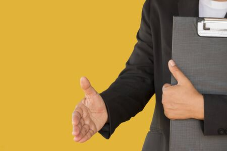 young business woman shaking hand isolated on yellow background 写真素材