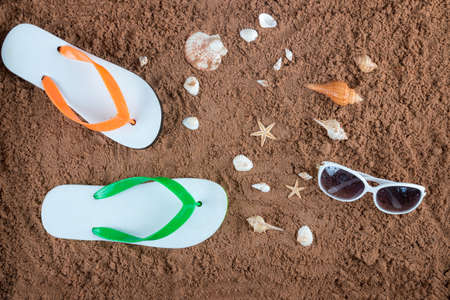 Summer beach sea accessories on sand beach, Summer background Holiday vacation travel concept