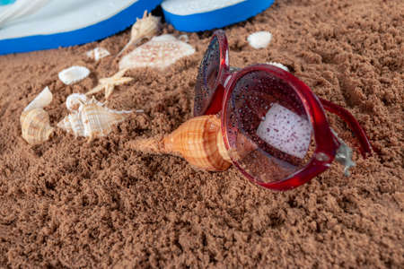 Summer beach sea accessories on sand beach, Summer background Holiday vacation travel concept Stock Photo
