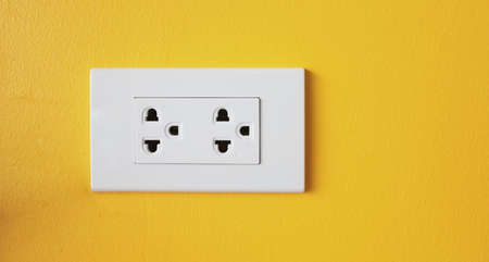 The power sockets on the walls are painted in bright yellow. Reklamní fotografie