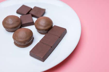 Valentine dark chocolate on pink background, Valentines Day Theme