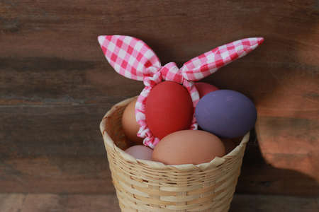 Easter background with Easter eggs on old wooden background