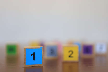 Wooden blocks with numbers, The concept of being a winning person and being a chosen person.