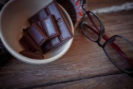 Valentine dark chocolate on old wooden background