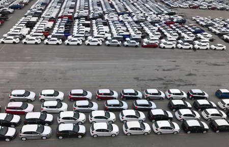 Many cars from the factory prepare to be transported at the port.