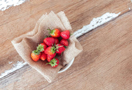 Strawberry on old wooden background, love and valentine theme