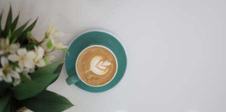 A coffee mug with latte art in a coffee shop.
