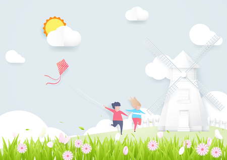 Spring season concept. Boy and girl playing kite with Windmills