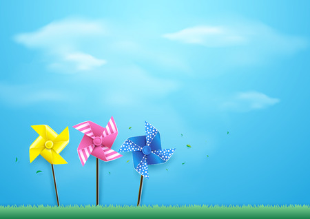 Windmills blowing in the wind on blue sky. Paper art and craft style