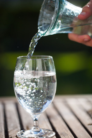 springwater: pouring a glass of water from bottle
