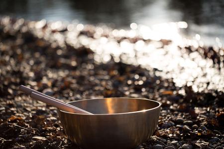 bronze bowl: bronze bowl on lake