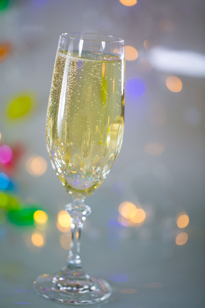 Champagne glass with bokeh - at the end of the year Stock Photo